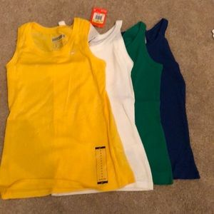 4 Nike tops. Size small.